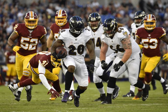 Former Baltimore Ravens running back Terrance West (28) charges ahead of Washington Redskins defenders on a first down to the two-yard line during the first half of their NFL preseason game on August 10, 2017 at M&T Bank Stadium in Baltimore, Maryland. Photo by David Tulis/UPI