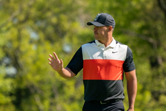 Brooks Koepka waves on the 14th green during the first round at the PGA Championship on Thursday at The Black Course at Bethpage State Park in Farmingdale, New York. Photo by Corey Sipkin/UPI