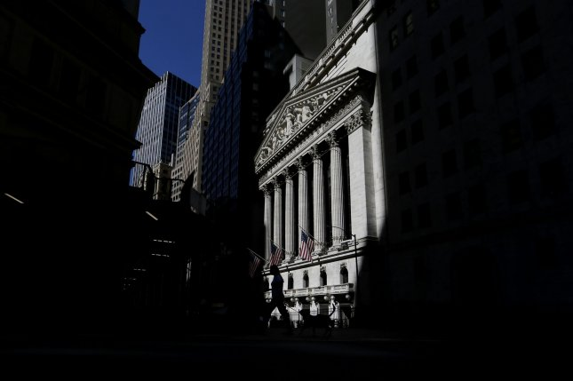 Sunlight hits the front of the New York Stock Exchange Friday after the opening bell on Wall Street in New York City. Photo by John Angelillo/UPI