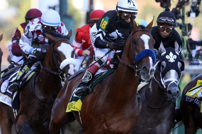 Jockey John Velazquez riding Authentic leads the field they round the first turn in the Kentucky Derby at Churchill Downs on September 5 in Louisville, Ky. Photo by John Sommers II/UPI