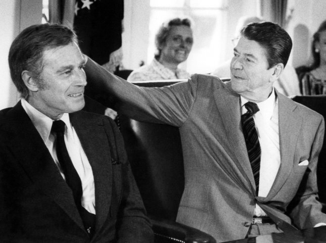 Charlton Heston died at the age of 84 at his home in Beverly Hills on April 5, 2008. He is seen in this June 1, 1981 file photo with President Ronald Reagan during a meeting with the Presidential Arts and Humanities Task Force. (UPI Photo/Larry Rubenstein/Files)