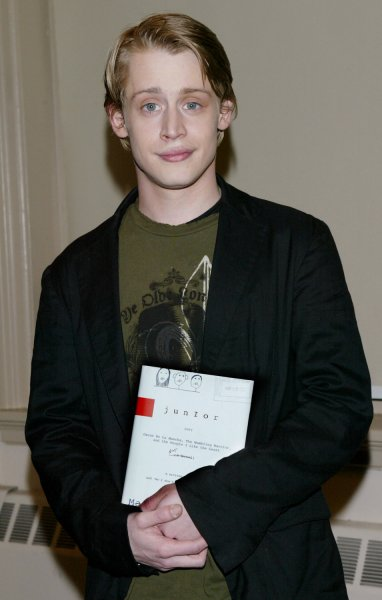 Actor Macaulay Culkin poses with his new book Junior during a book signing on March 13, 2006 in New York City. Culkin, who was the highest-paid child star ever, wrote a story based on his dysfunctional family upbringing. (UPI Photo/Monika Graff)
