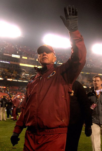 Washington Redskins head coach Joe Gibbs walks off the field after his team defeated the Dallas Cowboys 27-6 at FedEx Field in Landover, Maryland on December 30, 2007. (UPI Photo/Kevin Dietsch)