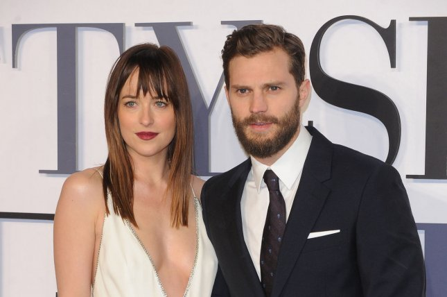 Dakota Johnson (L) and Jamie Dornan at the London premiere of Fifty Shades of Grey on February 12, 2015. The pair play Anastasia Steele and Christian Grey in the Fifty Shades movies. File Photo by Paul Treadway/UPI