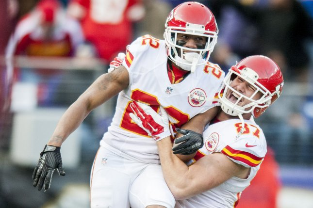 Kansas City Chiefs' tight end Travis Kelce hugs cornerback Marcus Peters as they celebrate Peters' interception return for a touchdown in a game against the Baltimore Ravensin 2015. Photo by Pete Marovich/UPI