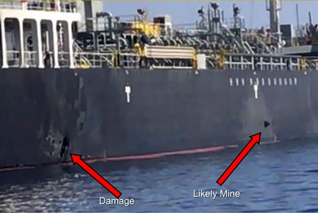 U.S. Central Command said damage from the explosion (left arrow) and a limpet mine (right arrow) are seen Thursday on the hull of the civilian vessel M/V Kokuka Courageous in the Gulf of Oman. Photo by U.S. Navy/UPI