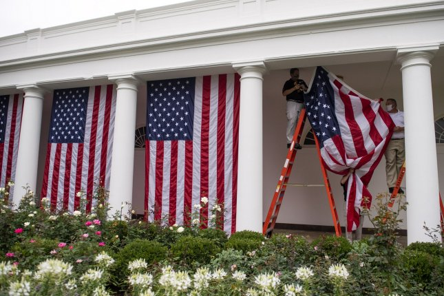 American flags are seen at the White House in Washington, D.C., on Saturday after President Donald Trump formally nominated Amy Coney Barrett to succeed Ruth Bader Ginsburg on the U.S. Supreme Court bench. Photo by Kevin Dietsch/UPI