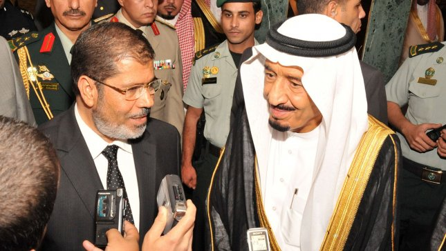 A handout photograph made available by the Egyptian Presidency on 12 July 2012, shows Egypt's President Mohamed Morsi (L) and Saudi Arabia Crown Prince Salman bin Abdul-Aziz Al Saud (R) speaking to journalists following their meeting in Jeddah, Saudi Arabia, late July, 11, 2012. UPI/POOL