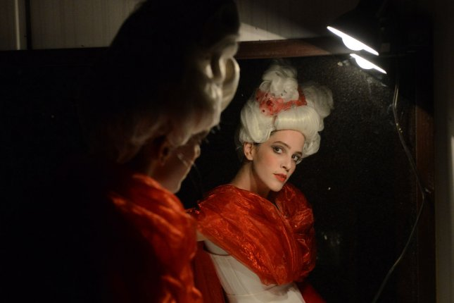 An opera singer in costume looks in the mirror before a performance. UPI/Debbie Hill