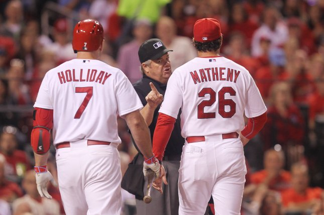 Home plate umpire Joe West warns St. Louis Cardinals manager Mike Matheny after ejecting Matt Holliday from the game in the seventh inning during a game against the Milwaukee Brewers at Busch Stadium in St. Louis on June 2, 2015. Photo by Bill Greenblatt/UPI