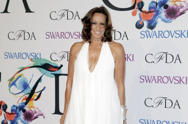 Donna Karan arrives on the red carpet at the 2014 CFDA fashion awards June 2, 2014, at Alice Tully Hall, Lincoln Center in New York City. Donna Karan International announced Tuesday that Karan is stepping down from the company. File photo by John Angelillo/UPI