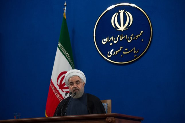 Iranian President Hassan Rouhani makes a comment during a press conference in Tehran in 2015. On Tuesday, Iran's hardline judiciary sentenced four journalists to long prison sentences for alleged crimes against national security. The journalists were supportive of Rouhani's advocacy for new press freedoms, a concept the nation's conservative courts oppose. File Photo by Ali Mohammadi/UPI