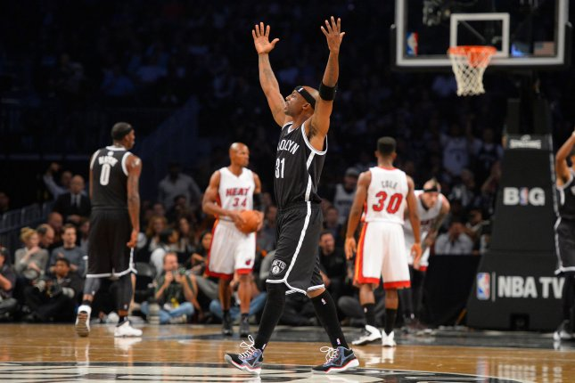 Former Brooklyn Nets shooting guard Jason Terry (31) reacts with fans during the first quarter against the Miami Heat at Barclays Center in New York City on November 1, 2013. File photo by Rich Kane/UPI