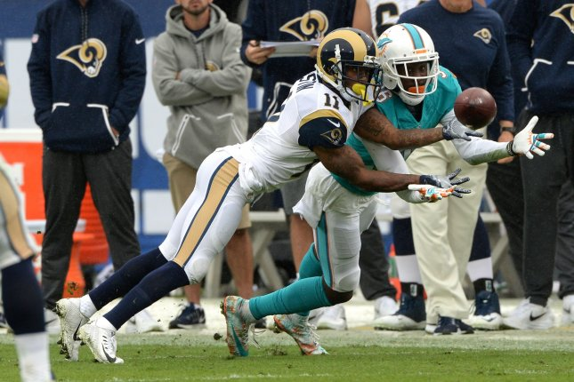 Los Angeles Rams receiver Tavon Austin (11) and Miami Dolphins defensive back Tony Lippett (36) battle for the ball on November 20, 2016 at the LA Coliseum in Los Angeles. File photo by Jon SooHoo/UPI