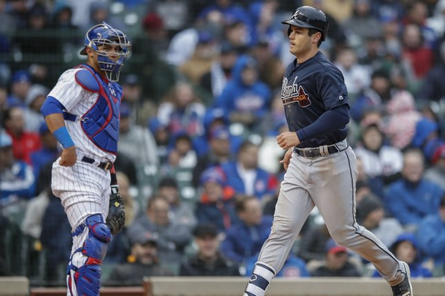 Atlanta Braves right fielder Preston Tucker (R) crosses home plate after hitting three-run home run off Chicago Cubs starting pitcher Yu Darvish in the fifth inning of a baseball game Friday at Wrigley Field in Chicago. Photo by Kamil Krzaczynski/UPI