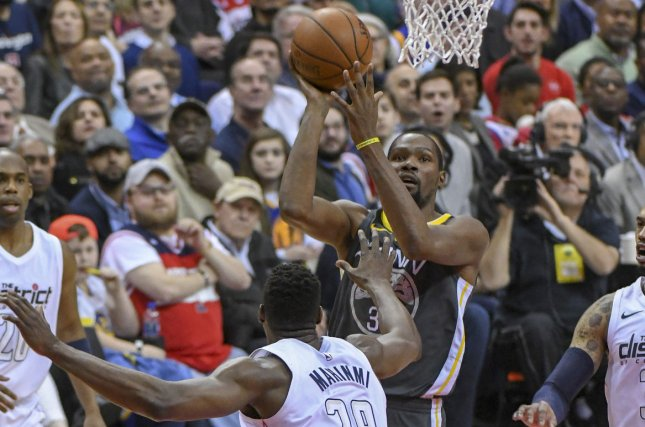 Golden State Warriors forward Kevin Durant (35) scores in the first half  against Washington Wizards center Ian Mahinmi (28) on February 28, 2018 at  Capital ...