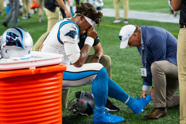 Carolina Panthers quarterback Cam Newton (1) reacts while his left foot is worked on by the team's medical staff. He aggravated the Lisfranc injury in Week 2 against the Tampa Bay Buccaneers. File Photo by Matthew Healey/UPI