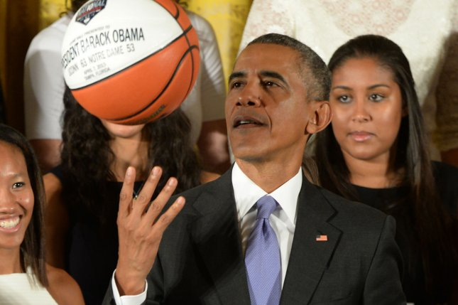 Former President Barack Obama (C), shown Sept. 15, 2015, is an avid basketball fan who has partnered with multiple NBA players on several projects. He also took part in All-Star festivities in his hometown of Chicago last year. File Photo by Pat Benic/UPI