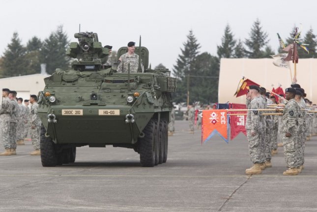 A Stryker vehicle carrying reviewing officers inspects the troops during welcome home ceremonies for the 3rd Brigade , 2nd Infantry Division at Fort Lewis in Tacoma, Washington on October 11, 2007. Soldiers from the 3rd Stryker Brigade were deployed in Iraq from June 2006 to September 2007. (UPI Photo/Jim Bryant).
