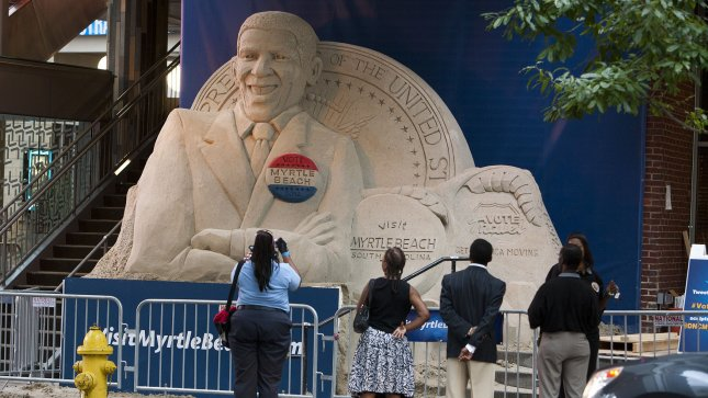 A caricature sculpture of President Barack Obama draws attention in downtown at the 2012 Democratic National Convention in Charlotte, North Carolina on September 1, 2012. UPI/Gary C. Caskey