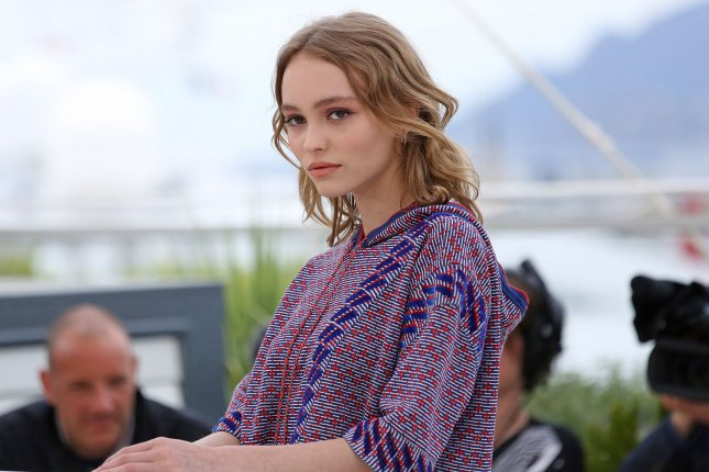 Lily-Rose Depp arrives at a photocall for the film La Danseuse (The Dancer) during the 69th annual Cannes International Film Festival on May 13, 2016. The actress has defended her father Johnny Depp amid allegations of abuse from his wife Amber Heard who has filed for divorce and was granted a restraining order. File Photo by David Silpa/UPI