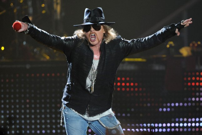 Axl Rose, the lead singer and only original member of the current rock band Guns N' Roses, performs Welcome to the Jungle at the Forum in Inglewood, Calif. on December 21, 2011. He will fill in for AC/DC frontman Brian Johnson on an upcoming joint tour. File Photo by Jim Ruymen/UPI