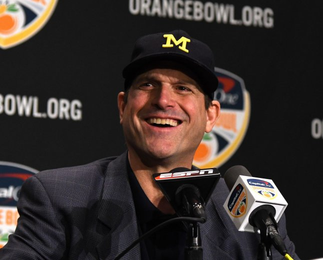 Michigan Wolverinescoach Jim Harbaugh answers questions prior to the Orange Bowl last December. Photo by Gary I Rothstein/UPI