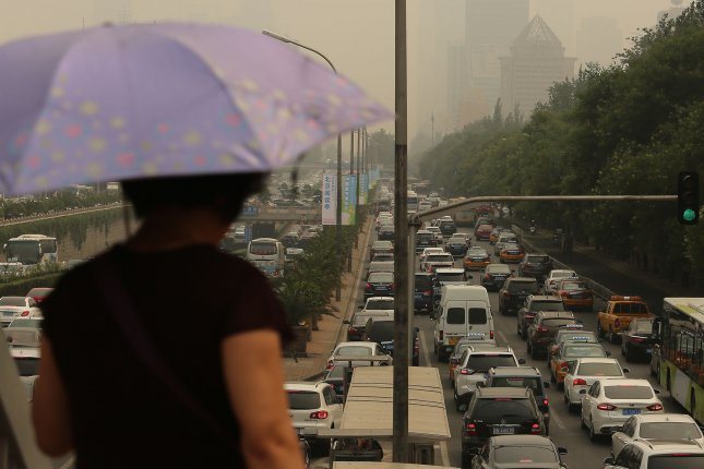 Researchers say that a rise in COPD worldwide among nonsmokers can be blamed on comorbidities and exposure to environmental chemicals. Pictured, heavy traffic inches along on a main ring road under heavy pollution in Beijing in 2016. File Photo by Stephen Shaver/UPI