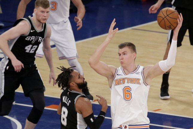 Former New York Knicks forward Kristaps Porzingis (R) suffered a bloody gash to his head and a ripped shirt during an altercation in his hometown over the weekend. File Photo by John Angelillo/UPI