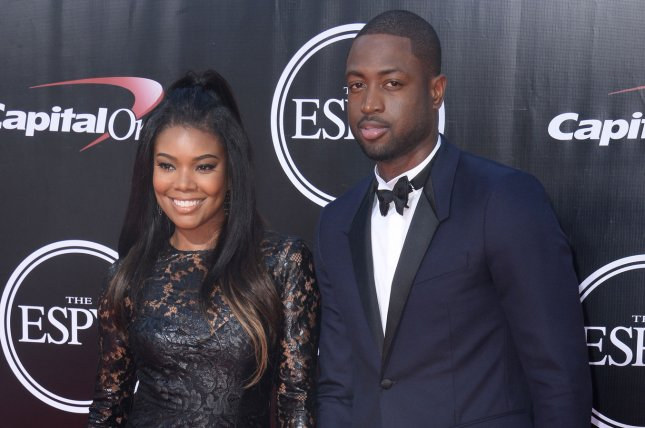 Gabrielle Union (L), pictured with Dwyane Wade, said Wade has been experiencing basic day-to-day life for the first time since leaving the Miami Heat. File Photo by Jim Ruymen/UPI