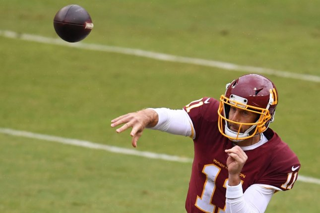 Quarterback Alex Smith, who spent the last three seasons with the Washington Football Team, announced his retirement Monday. File Photo by Kevin Dietsch/UPI