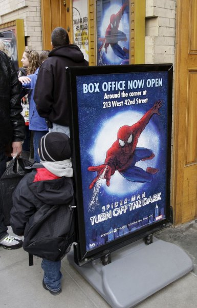 People gather outside the site of Spider-Man: Turn Off The Dark the day after the official opening is postponed again as the musical will undergo an overhaul which could delay the opening until June at Foxwoods Theatre in New York City on March 9, 2011. UPI/John Angelillo