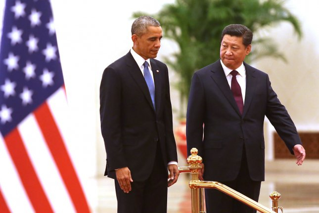 U.S. President Barack Obama and Chinese President Xi Jinping attend a welcoming ceremony at the Great Hall of the People in Beijing in 2014. Xi and Obama have met four times since Xi assumed office in March 2013, and Obama is expected to welcome Xi to the White House during the Chinese leader's visit Sept. 24- 25. File Photo by Stephen Shaver/UPI