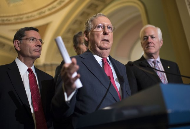 Senate Majority Leader Mitch McConnell, R-Ky. (C) speaks to the media on November 16. Thursday he praised preservation of sanctions against Iran after the U.S. Senate unaminously passed a bill approving an extension of U.S. sanctions. Photo by Kevin Dietsch/UPI