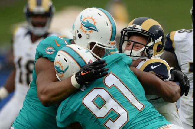 Los Angeles Rams quarterback Jared Goff (16) is sacked by Miami Dolphins defensive linemen Cameron Wake (91) and Ndamukong Suh at the LA Coliseum in Los Angeles, on November 20, 2016. File photo by Jon SooHoo/UPI