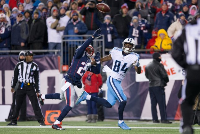 Tennessee Titans wide receiver Corey Davis (84) pulls in a 15-yard touchdown while covered by New England Patriots cornerback Malcolm Butler (21) in the first quarter of the AFC Divisional round playoff game on January 13 at Gillette Stadium in Foxborough, Massachusetts. Photo by Matthew Healey/UPI