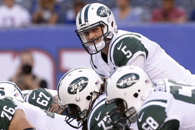 New York Jets quarterback Christian Hackenberg stands under center in the first quarter of a preseason game against the New York Giants on August 26 at MetLife Stadium in East Rutherford, N.J. Photo by John Angelillo/UPI