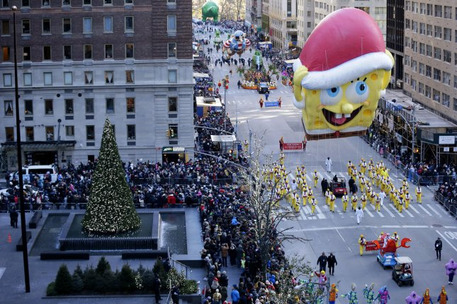 The SpongeBob SquarePants balloon and other balloons and floats move down the parade route on Sixth Avenue at the 92nd Macy's Thanksgiving Day Parade in New York City on Thursday. Photo by John Angelillo/UPI
