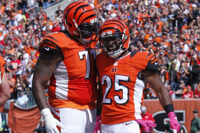 Cincinnati Bengals running back Giovani Bernard (25) celebrates a touchdown with Andre Smith (71) at Paul Brown Stadium in Cincinnati, File photo by John Sommers II/UPI