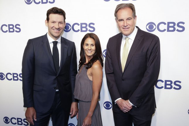Tony Romo, Tracy Wolfson and Jim Nantz arrive on the red carpet the 2018 CBS Upfront at The Plaza Hotel on May 16 in New York City. Photo by John Angelillo/UPI