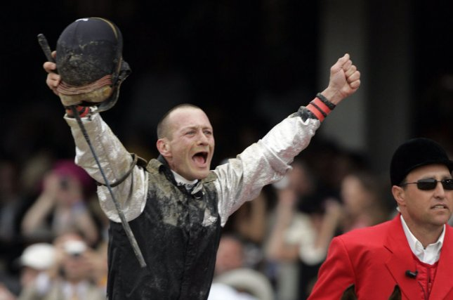 Jockey Calvin Borel, riding Mine That Bird, celebrates his victory in the 135th running of the Kentucky Derby at Churchill Downs in Louisville, Kentucky, on May 2, 2009. The Mine That Bird Derby is named for the victorious horse. File Photo by Mark Cowan/UPI