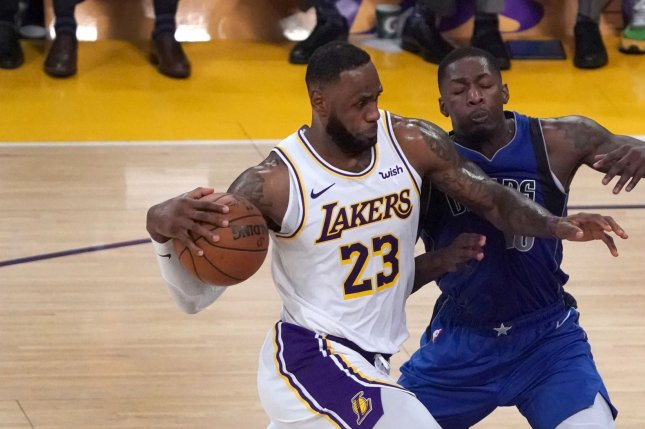 Los Angeles Lakers star LeBron James (L) had 13 points and 13 assists in a win against the Dallas Mavericks on Sunday in Los Angeles. Photo by Jon SooHoo/UPI