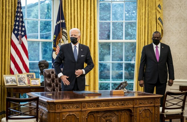 On Thursday, Defense Secretary Lloyd Austin, R., pictured with President Joe Biden in the Oval Office, ordered a global review of U.S. troop strength, strategy and missions. Pool Photo by Doug Mills/UPI