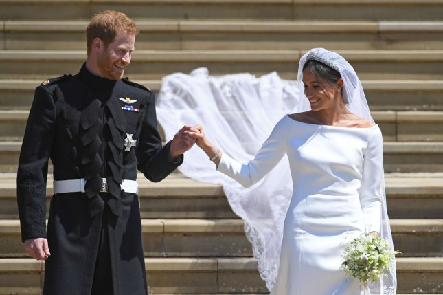 Britain's Prince Harry and Meghan Markle are seen during their wedding at Windsor Castle in Windsor, Britain, on May 19, 2018. File Photo by Neil Hall/UPI