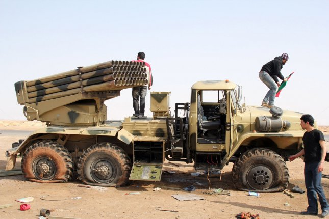 Libyan rebels look over a damaged pro-Gadhafi rocket vehicle after a fight with rebels in the western city of Ajdabiya, Libya on April 13, 2011. UPI/Tarek Alhuony