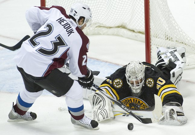 Colorado's Milan Hejduk has a shot blocked by Boston goalie Tim Thomas in a game in Denver Jan. 22, 2011. UPI/Gary C. Caskey