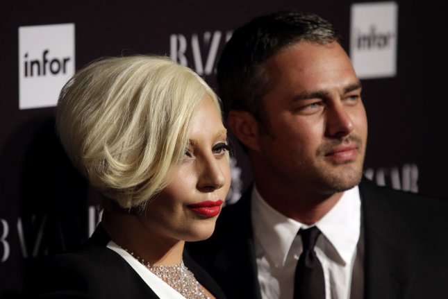 Lady Gaga and Taylor Kinney reportedly held a commitment ceremony. (UPI/John Angelillo)
