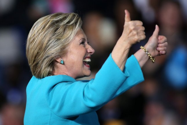 Supporters cheer as Democratic presidential candidate Hillary Clinton gives the thumbs up after speaking at a campaign rally in Cleveland, Ohio on Sunday. FBI Director James Comey told lawmakers Sunday the agency hasn't changed its opinion that Clinton should not face criminal charges after a review of new emails. Photo by Aaron Josefczyk/UPI