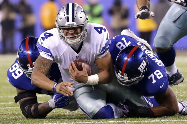 New York Giants Romeo Okwara sacks Dallas Cowboys Dak Prescott for a 5 yard  loss in the first quarter in week 14 of the NFL at MetLife Stadium in East  ... fdcd997a4