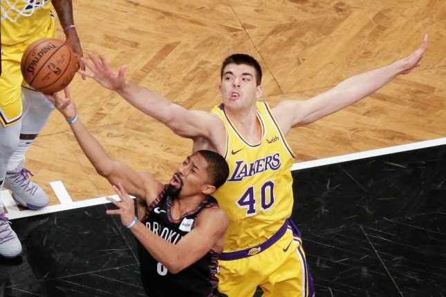 Los Angeles Lakers defender Ivica Zubac defends Brooklyn Nets guard Spencer Dinwiddie who drives to the basket in the first quarter on December 18 at Barclays Center in New York City. Photo by John Angelillo/UPI